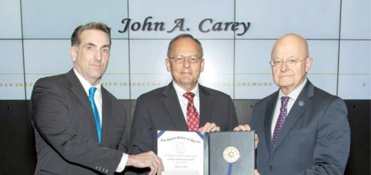 John Carey, center, was recently awarded the Intelligence Community Inspector General Lifetime Achievement Award by the Honorable I. Charles McCullough, III, the Intelligence Community IG, left, and the Honorable James R. Clapper, director of National Intelligence. (Submitted photo)