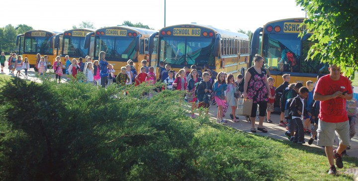School buses drop students off at Carey Ridge Elementary on the first day of school. A new pilot program will provide Westfield Washington Schools with six buses equipped with seatbelts in the next two to three years. (File photo)