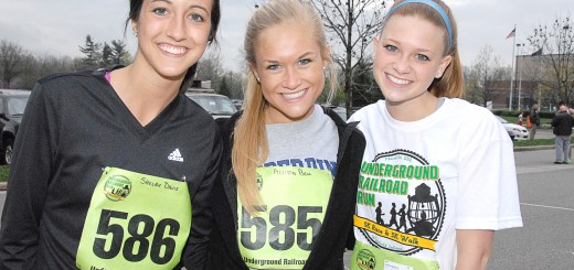 Former students Shelby Davis, Allison Bell and Lauren Merkle are all smiles as they prepare for the race. (File photo)