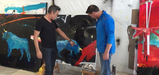 Michael Gorman, left, shows paintings to Evan Lurie at the Evan Lurie Gallery.
