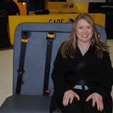 Westfield Washington School Board Member Amber Willis tests out the school bus seat. (Photo by Mark Ambrogi)