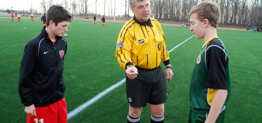 Referee Matt Curtis asks Westfield Select's Michael Kwiatkowski to call the coin flip with Wilson Freige of FC Pride on March 14, 2014. It was the first coin flip and soccer game at Grand Park. (File photo)
