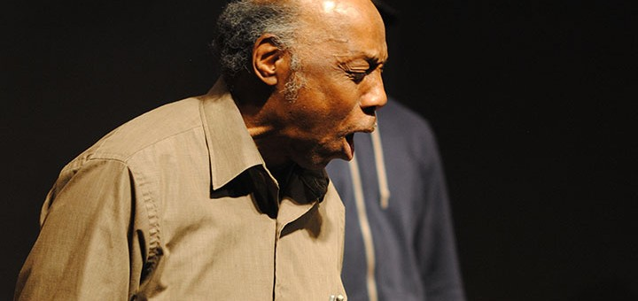 """Jim Washington sings """"River Jordan,"""" the showstopper and conclusion of the first act. (Photo by Robert Herrington)"""