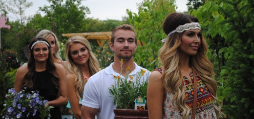 """Jimmy Pierle, center, waits to walk with Hollie Woodward down the runway. Pierle carried plants down the runway with different models throughout the """"Fashion in Bloom"""" fashion show."""
