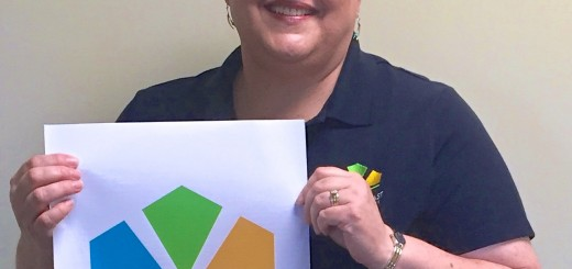 Community Relations Manager Cheryl Jurgens shows off the new Hamilton East Public Library logo. (Photo by Anna Skinner)