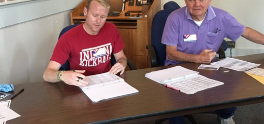 John Hart (left), Republican clerk, and Eugene Hunton (Democrat judge) assist voters at Westfield City Hall May 5. (Photo by Anna Skinner)