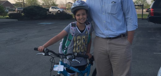 Jada Clevenger, a third grader, and Derrick Clevenger arrive at Westfield Lighting to participate in National Bike to School Day. (Photo by Anna Skinner)