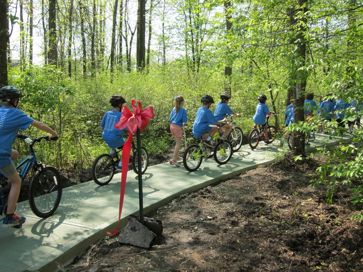Students in Kasey Cope's second grade class break in the new bike path. (Photo by Savannah Correll)