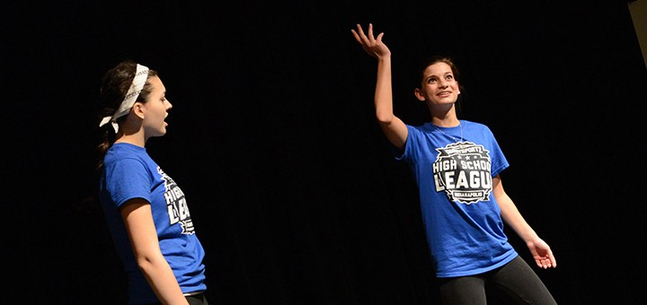 WHS's Bailey Salsberry and Paige Penry work with professionals to gain improv comedy skills. (Photo by Theresa Skutt)