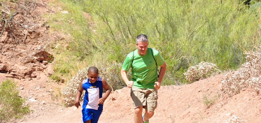 Tom Dickey runs with son, Tyler, up a hill on Camelback Mountain in Phoenix, Ariz.. (Submitted photo)