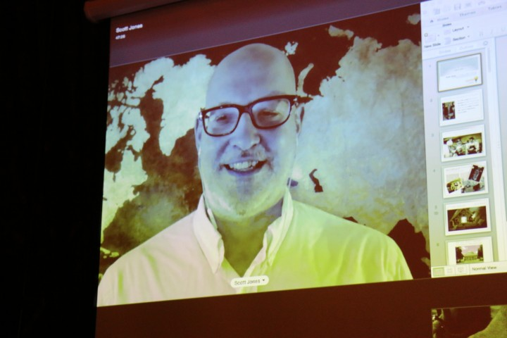 Scott Jones was unable to attend the event due to a medical illness, so he spoke via Skype from Hawaii.