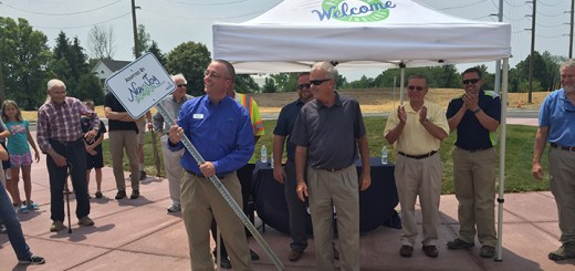 """hris Ductzworth (left), pastor at New Joy Lutheran Church, celebrates the new """"adopt-a-round- about"""" program with Mayor Andy Cook and other city officials. (Submitted photo)"""