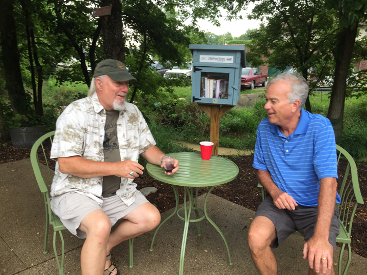 Steve Miller, landscape impressionist and Plein Air Painters' Association member, and Mayor Andy Cook brave the on-and-off rain and enjoy their time outside at the event. (Photo by Anna Skinner)