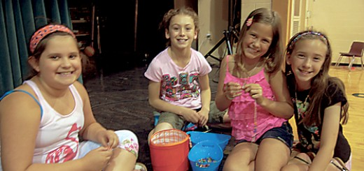 Third graders Izzy Ruffer, Rachel Beck, Rosemary Cronin and Kaitlyn McFarland create bracelets for patients at Riley Hospital for Children. (Photo by Heather Lusk)