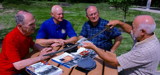 (Clockwise) Jack Shaffer, Terry Cross, Brad Rainier and Jim Tremblay discuss the features of a Civil War era sword. (Photo by James Feichtner)