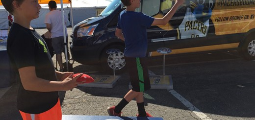 Jack Livingston, right, and Luke Titus play corn hole at the Fishers Freedom Festival.