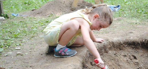 """Avery Gleim uses a trowel to look for objects in a dig site.""""What's Beneath the Surface"""" was held from July 11 to July 19."""