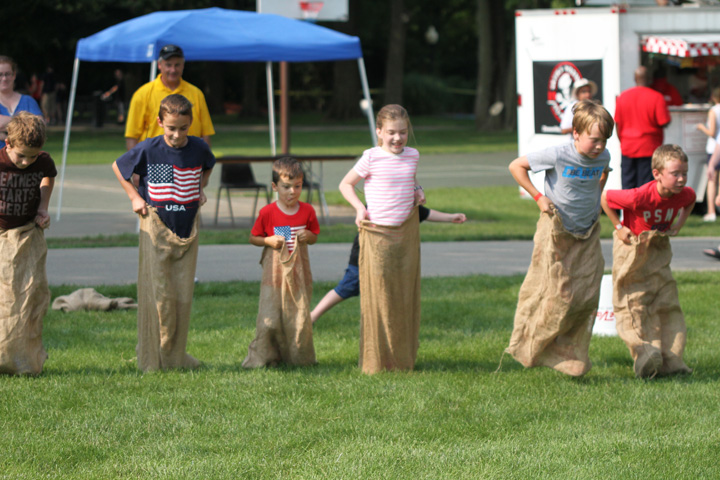 The boys and girls club of Zionsville sponsored kid activities including a sack race at this years 4th of July celebration in Lions Park. (Photo by Keith Shepherd)