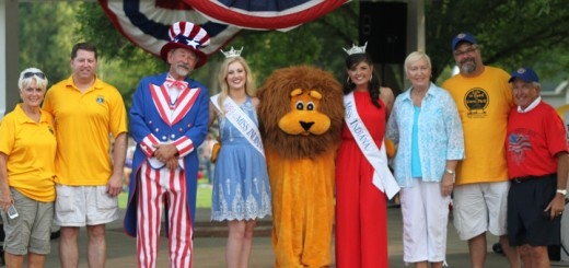 Opening ceremonies for the Lions Club 4th of July celebration at Lions Park. From Left to Right, Cheri McKamey, Tim Reinhart, Uncle Sam, Miss Indian Outstanding Teen Alyssa Hochstetlyer, The Lions Club Lion, Miss Indiana Morgan Jackson, Linda Johnson, Steve Gayheart, and Darryl Johnson. (Photo by Keith Shepherd)