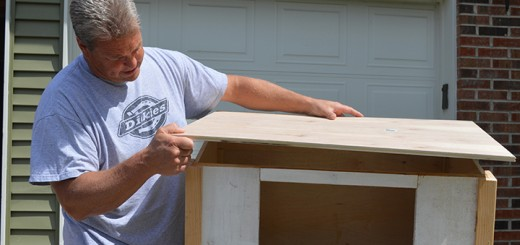 Jerry Stevens constructs the free library that will be placed and dedicated in Ritchey Woods Nature Preserve on July 21 at 6:30 p.m. (Photo by Morgen Stevens)