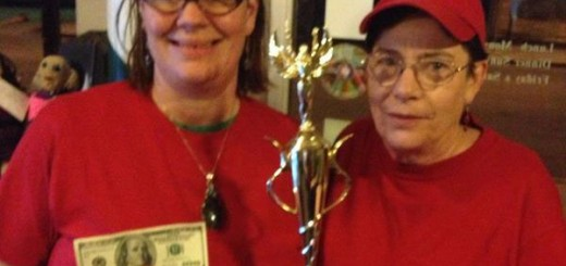 Thomas (left) shows off her $100 and trophy after winning the annual pizza bake-off next to her mom, Jan in 2013. (Submitted photo)