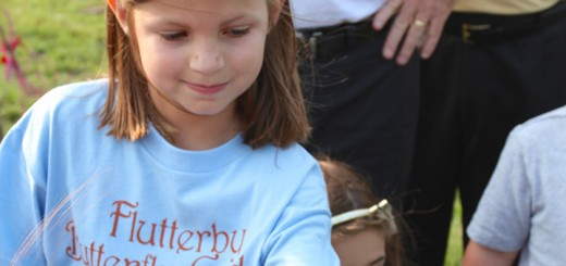 Haylee Holbrook waits for a monarch to take off during the butterfly release at the Flutterby Butterfly Garden. (Photo by Sadie Hunter)