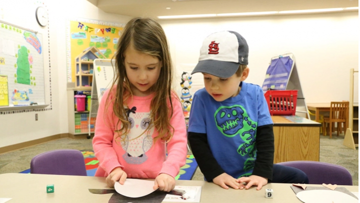 Caroline Cacioppo (left) and Will Ferrand assemble paper penguins in the preschool program at Union Elementary. (Photo by Ann marie shambaugh)