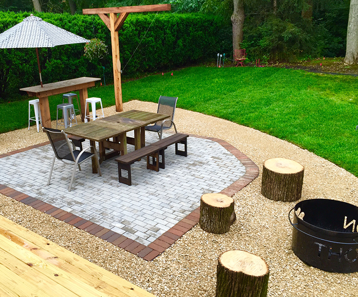 Diverse materials help define the somewhat separate living areas. The elegant clay pavers signal a more formal and rich dining area. (Submitted photo)