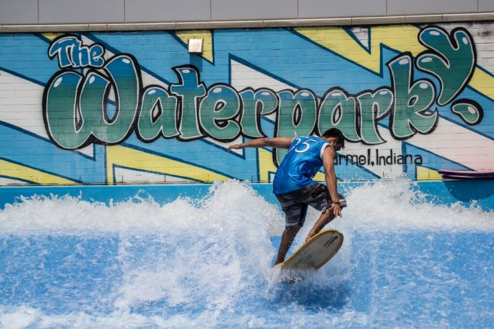 A Monon Community Center member takes a turn on the FlowRider surfing system. (Submitted photo courtesy of Carmel Parks and Recreation)