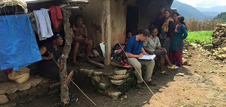 Rob Fauth, left, meets with people in Nepal to discuss their needs after the earthquake. (Submitted photo)