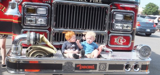 Bensom Holmes, left, and Anderson Myers rest on a Carmel Fire Department engine. (Photos by Kayla Nakeeb)