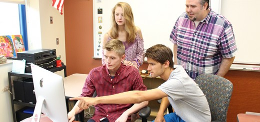 """HSE graduates from left, Nick Kinder, Marie Drascic, Bryce Reif and HSE teacher Jeremiah Follis edit their film content for their documentary """"None of the Above."""" (Photo by James Feichtner)"""