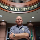 Fishers Police Chief George Kehl in the lobby of Fishers Police Department. Kehl announced his retirement for September 2016 after nearly four decades as chief (Photo by James Feichtner)