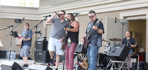 The band Tenth of Never performs at the Nickel Plate Amphitheater during National Night Out.