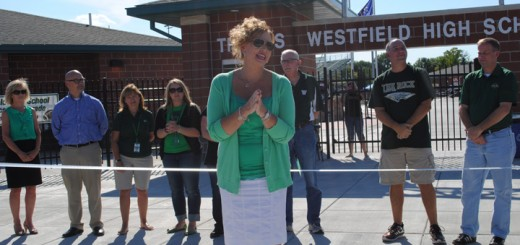 Dr. Stacey McGuire, principal of Westfield High School, speaks to the crowd just before cutting the ribbon.