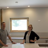 Dan Porzel, left, is the builder and owner of the passive house, and Cara Weber is the architect. (Photo by Lisa Price)