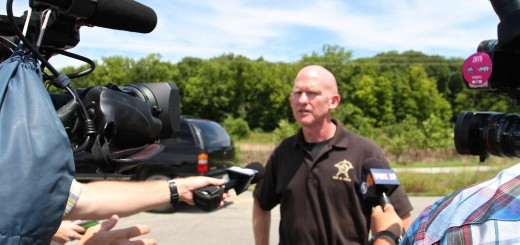 Deputy Bryant Orem, public information officer for the Hamilton County Sheriff's Office, talks to media about police and bomb squad findings at MacGregor Park on the afternoon of Aug. 4. (Photo by Sadie Hunter)