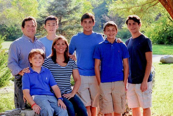 Jason Chen, third from left, is living with the Murvis family, which includes, from left, Michael, Gabe, Julie, Isaac, Sam and Joe. (submitted photo)