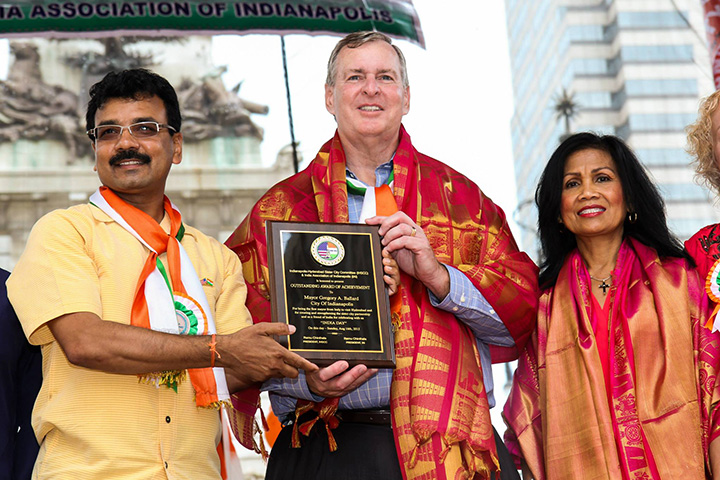 Raju Chinthala, left, presents an award to Indianapolis Mayor Greg Ballard, who is joined by his wife, Winnie, on behalf of the Indianapolis-Hyderabad Sister City Committee and India Association of Indianapolis. (Submitted photo)
