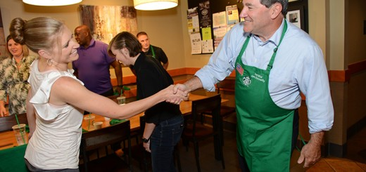 Sen. Joe Donnelly shakes hands with Miranda Goeb.