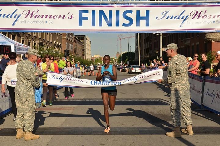 2014 Indy Women's Half Marathon winner Marion Kandie of Kenya crosses the finish line. (Submitted photo)