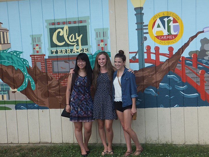 Katy Voor, Sydney Hartwick and Dana Wang with their mural. (Photo by Kayla Nakeeb)