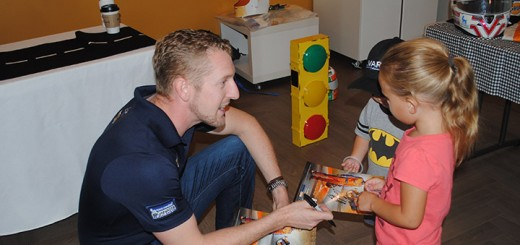 Charlie Kimball talks with Casey Quinn, 4, and brother Calvin, 3, from Carmel. (Photo by Mark Ambrogi)