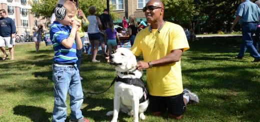 TJ Durbin, left, and Blair Clark, founder of Friends Helping Friends, visit with therapy dog Sunny.