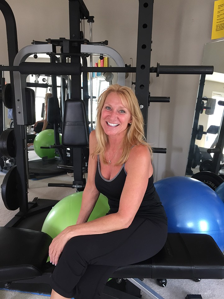 Sams at her in-home gym in Fishers. (Photo by James Feichtner)