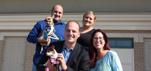 Ray Hurt and Ashley Looper, from back, with Fishers Mayor Scott Fadness and Hamilton County Humane Society Executive Director Rebecca Stevens with pups Turbo and Ruby Roo. (File photo)