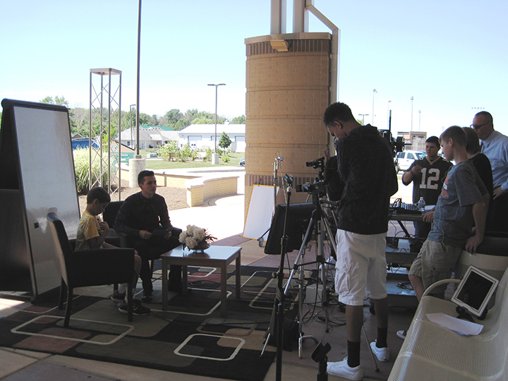Students broadcasting on one of their sets. (Submitted photo)