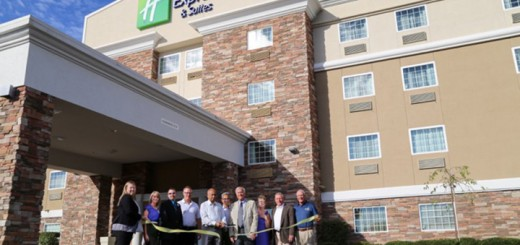 City officials, including Mayor Andy Cook, and hotel representatives cut the ribbon at the new location. (Submitted photo)
