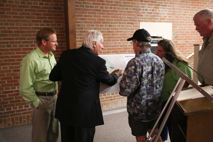 Attorney Mike Andreoli, second from left, explains plans for the Vonterra development after the parks board meeting. (Photo by Ann Marie Shambaugh)