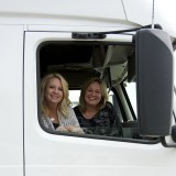 Jo Ellen Roberts, left, and Misty Boodt sit inside the cab of a Togo Express truck. (Photo by Lisa Price)